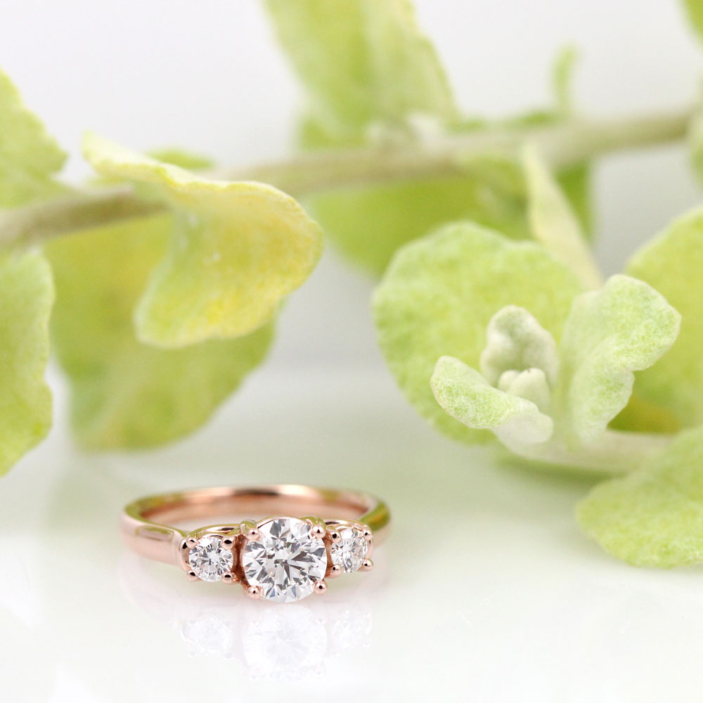 Classic three stone rose gold engagement ring