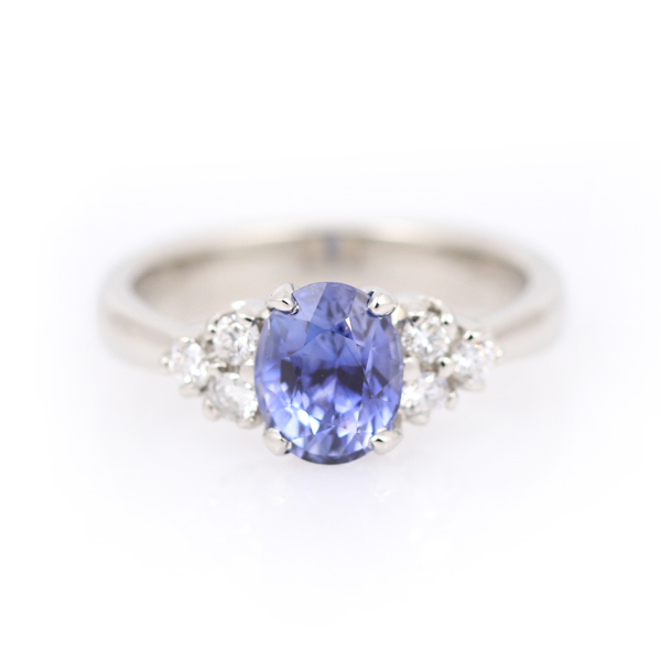 Oval sapphire and diamond engagement ring in 18k white gold.