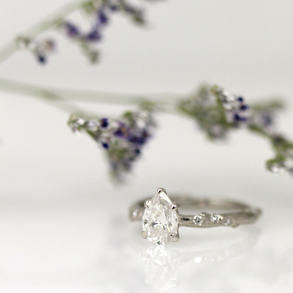 A pear shape diamond skinny twig engagement ring by Pippa Jayne Designs.