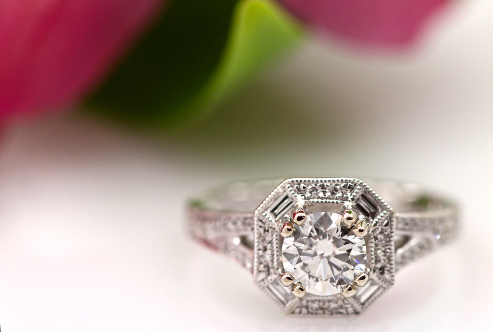 Modern vintage halo diamond engagement ring by A.Jaffe.