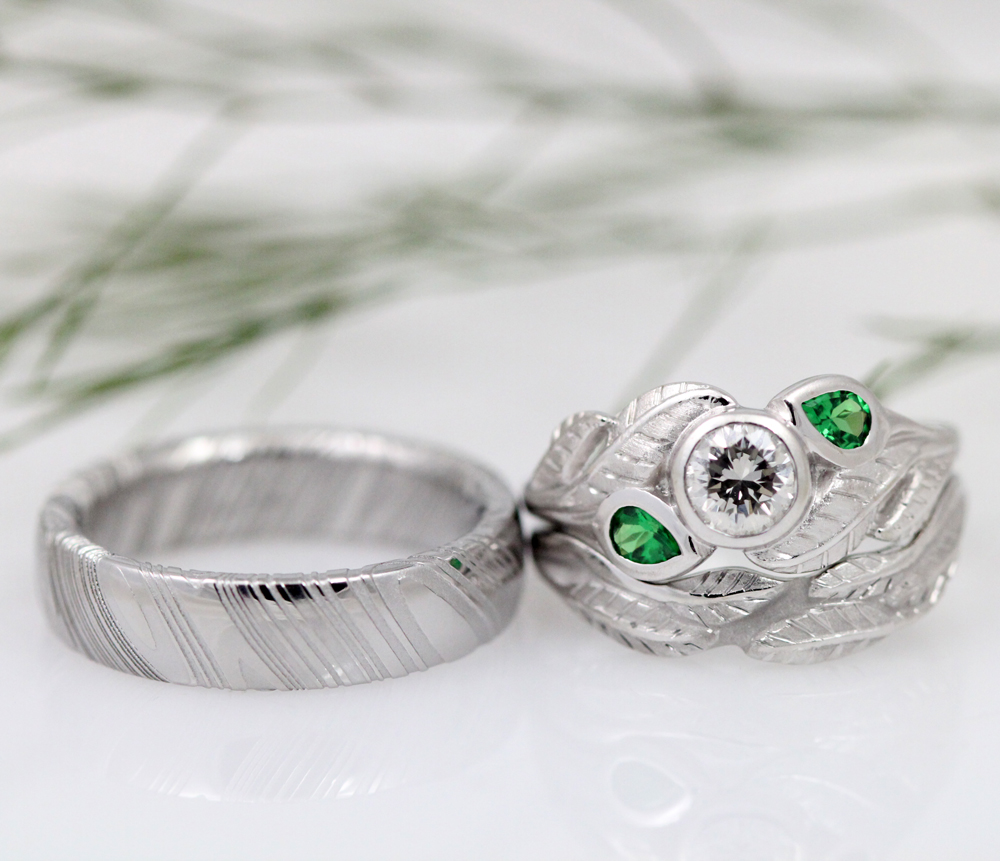 A handsome Damascus Steel wedding band and a leafy white gold wedding set with beautiful botanical detailing.
