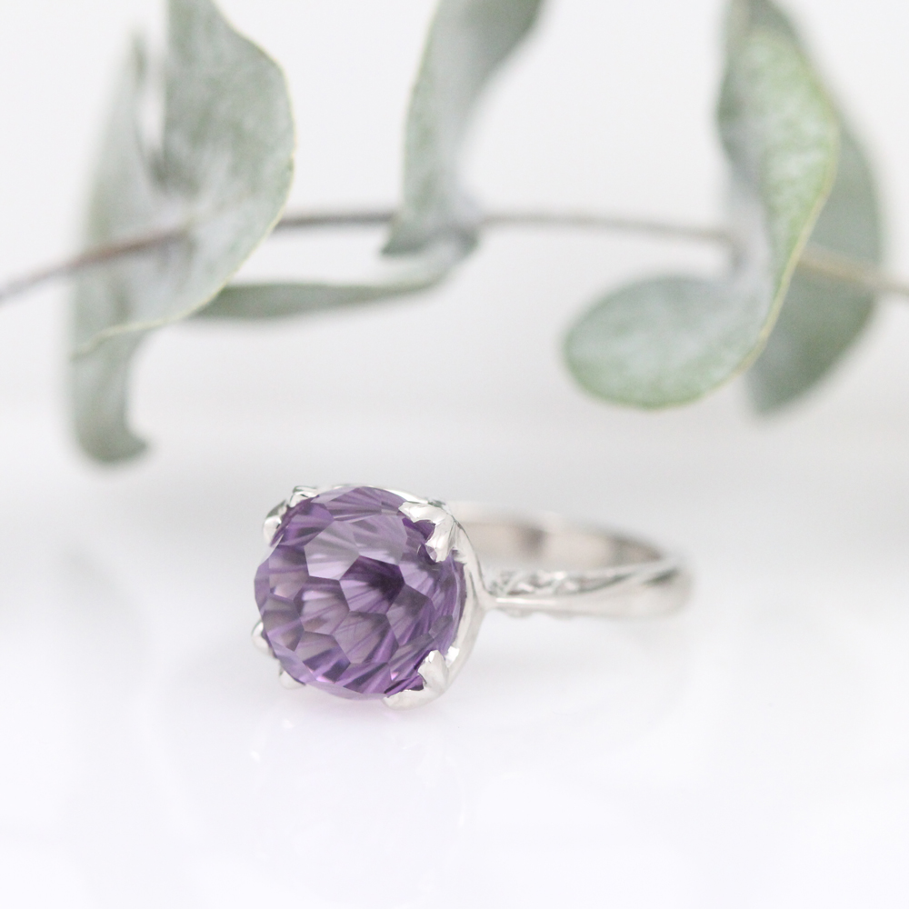 Daisy cut amethyst sparkles in this custom platinum ring by Abra.