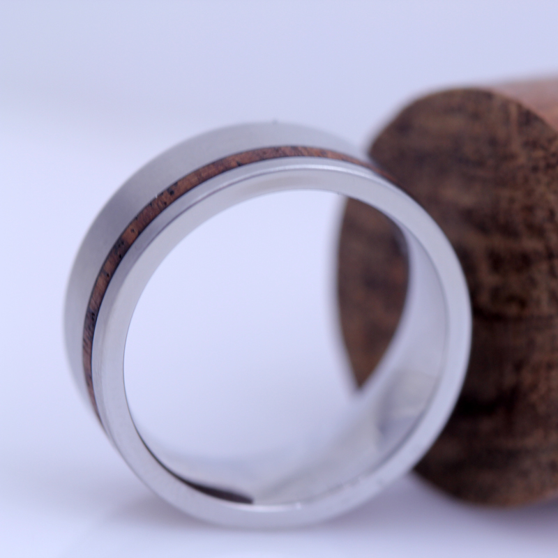 We inlaid a piece of the customer's heirloom walnut wood cane in this handsome steel band.