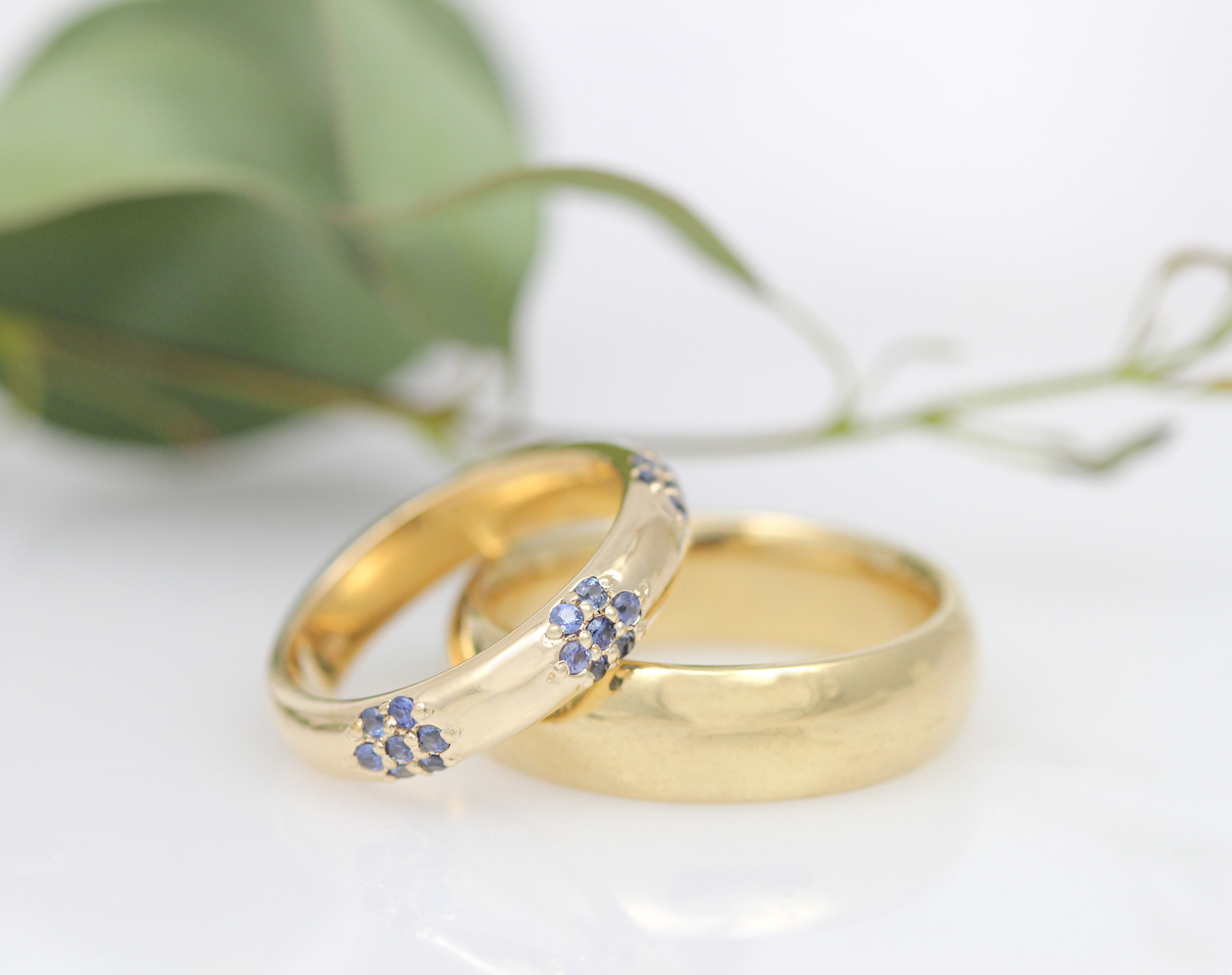 A discerning bride selected each dainty sapphire by hand to create the perfect one of a kind wedding band.