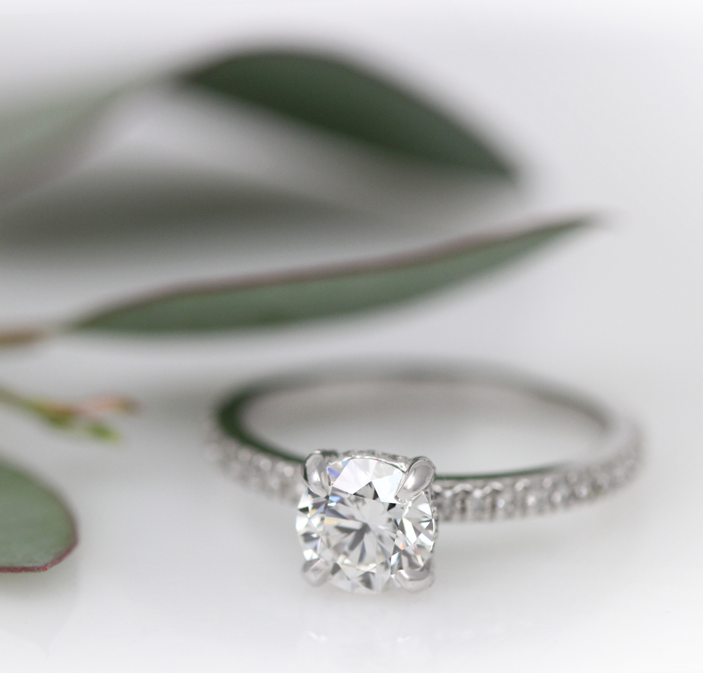 Classic round brilliant cut diamond engagement ring in white gold.