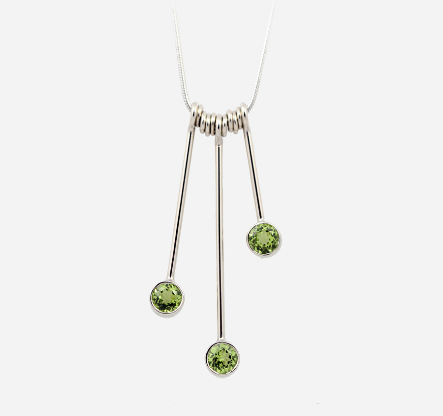Geometric drop stacking pendants with peridot in white gold