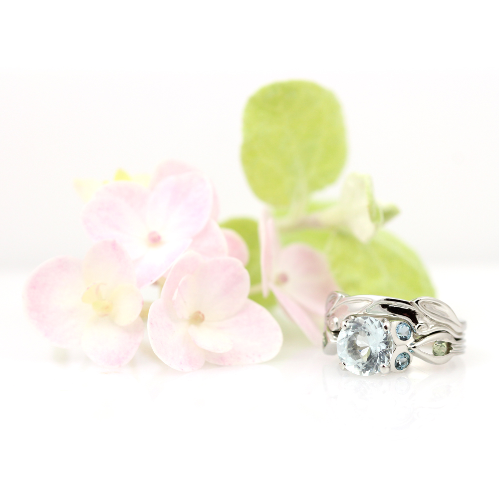 Brilliant aquamarine and peridot adorn this sculptural wedding set.