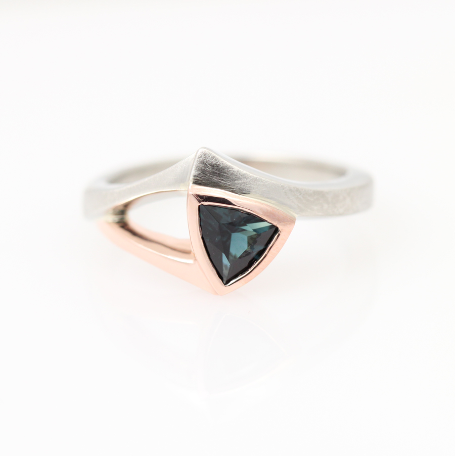 Bespoke white and rose gold engagement ring starring Indicolite tourmaline