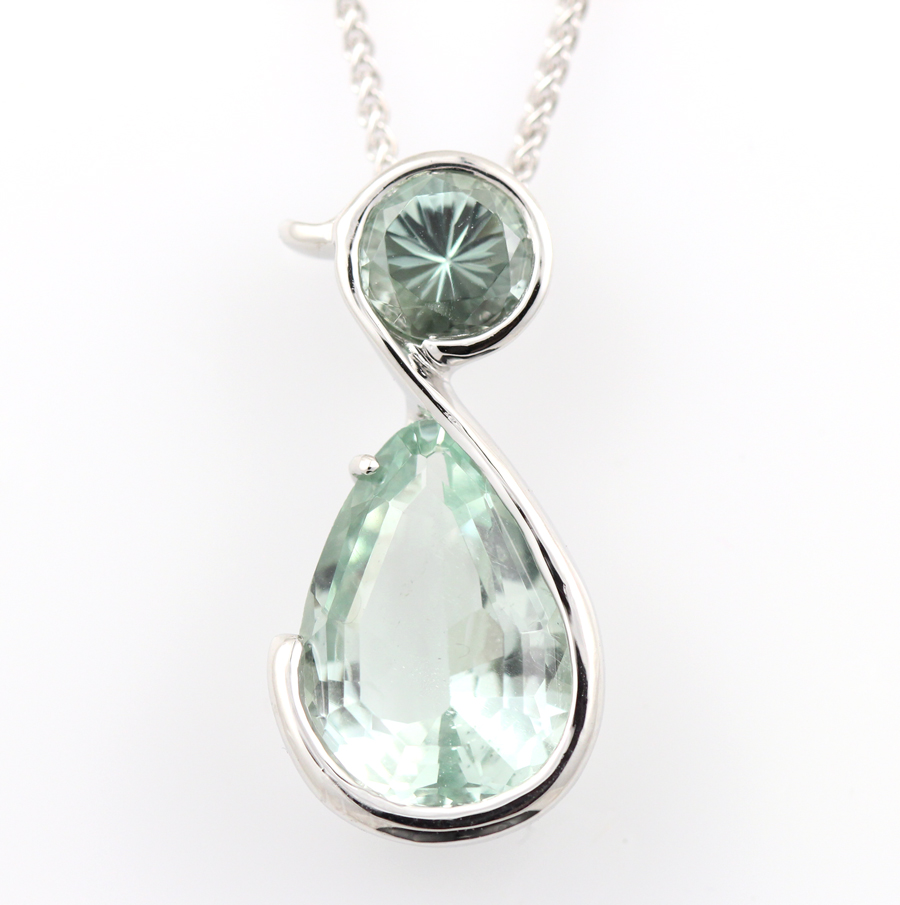 Bespoke platinum pendant with aquamarine
