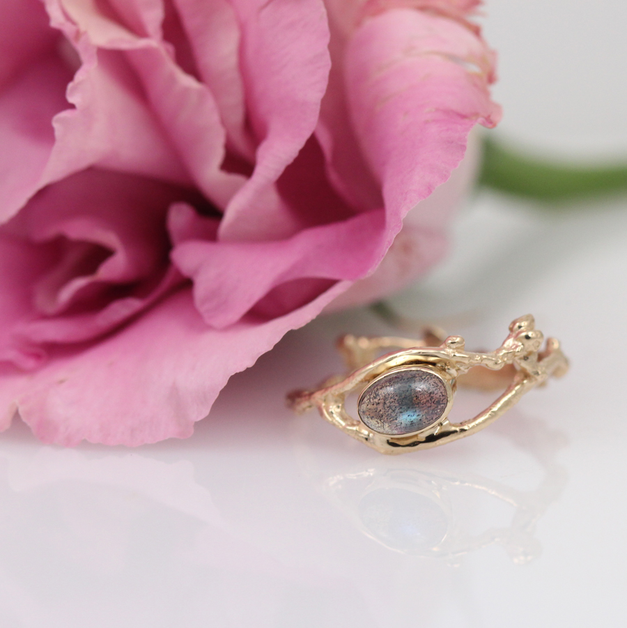 Bespoke delicate bud solitaire ring in rose gold with labradorite by Pippa Jayne Designs.