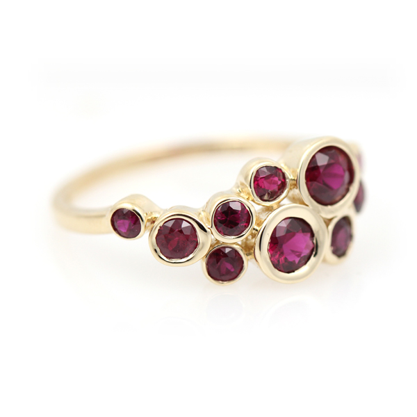 Bubbly bezels float burgundy, merlot and cabernet color rubies across the band in this celebratory 40th anniversary band.