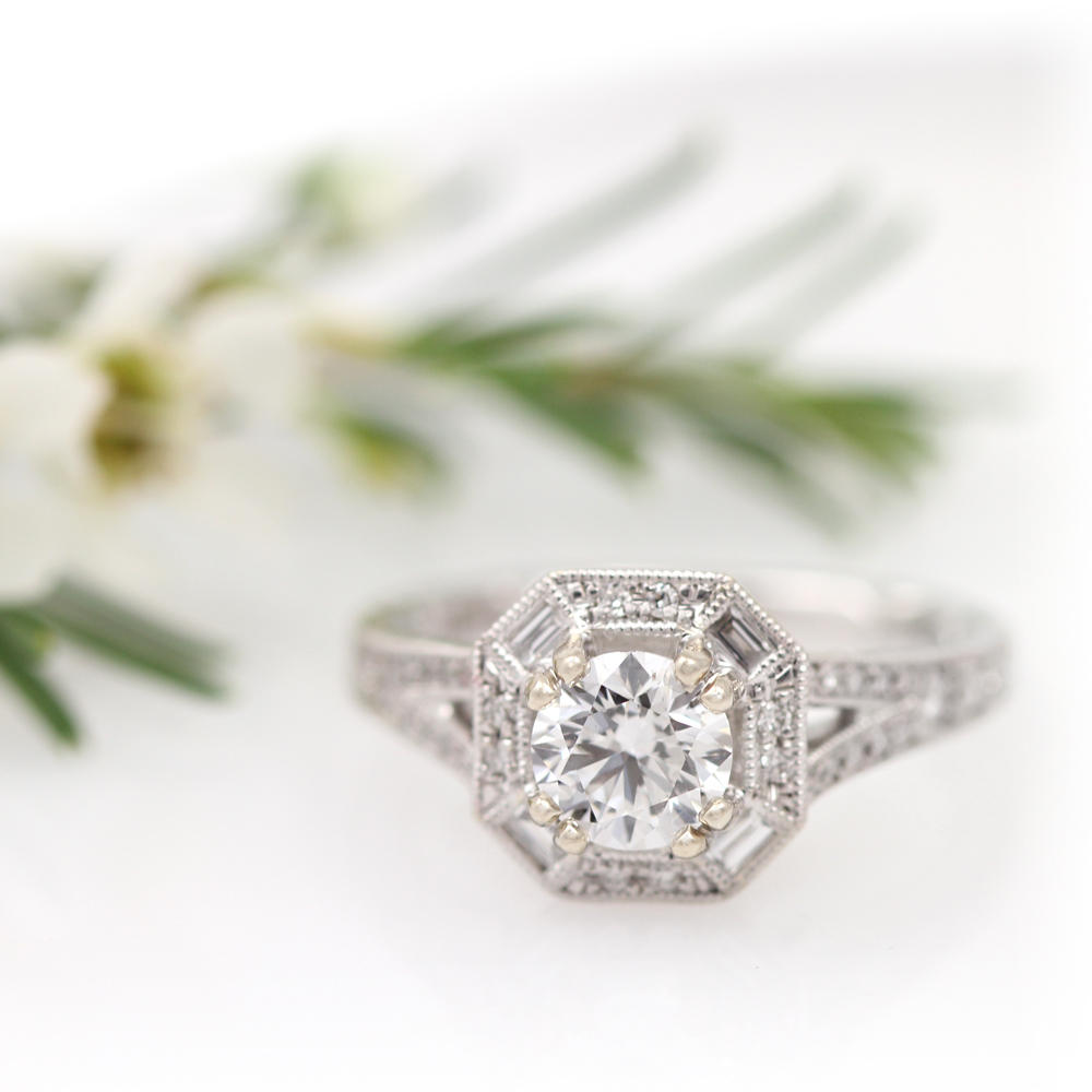 Diamond engagement ring with cushion shape milgrain halo.