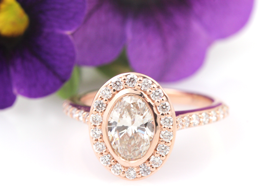 Oval halo engagement ring featuring lab grown diamonds in rose gold.