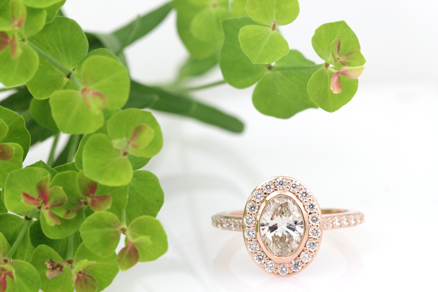 Rose gold oval halo engagement ring with lab grown diamonds.