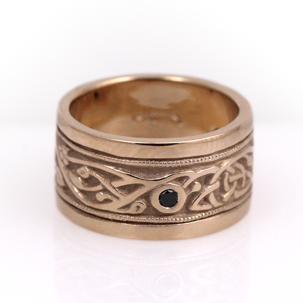Celtic knot wide band with a black diamond.