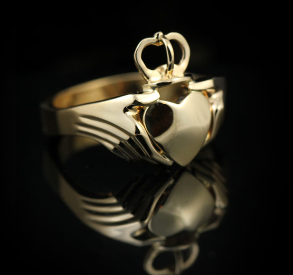 Golden claddagh ring.