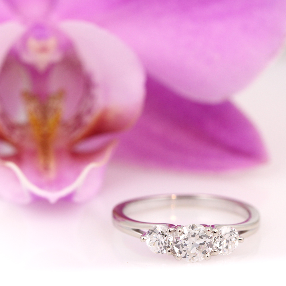 Timeless white gold three stone engagement ring using family diamonds.