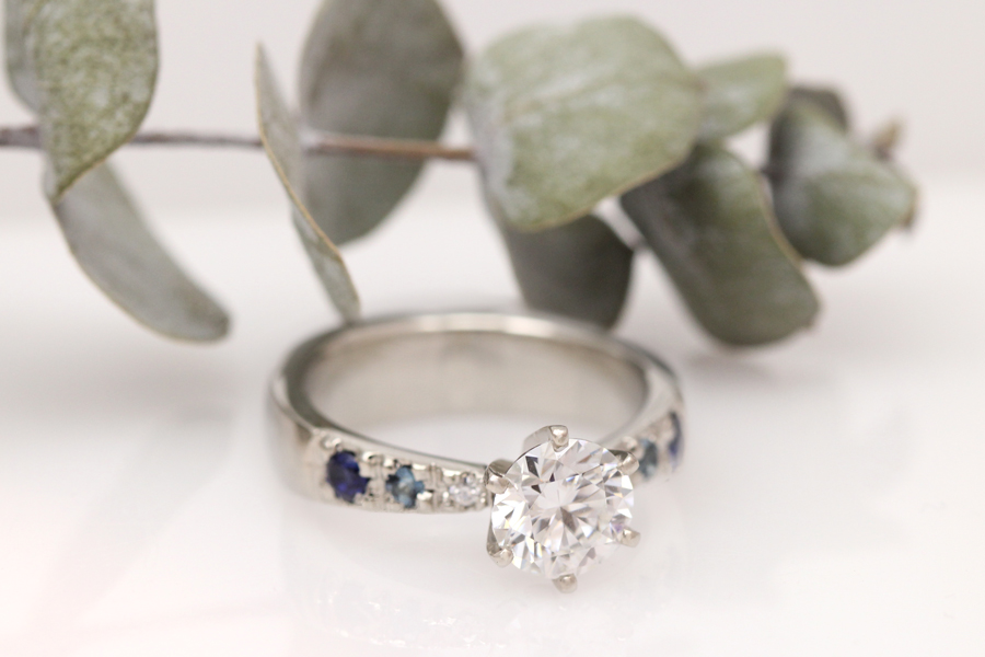 Ombre blue sapphires and moissanite give this glamorous engagement ring major sparkle.