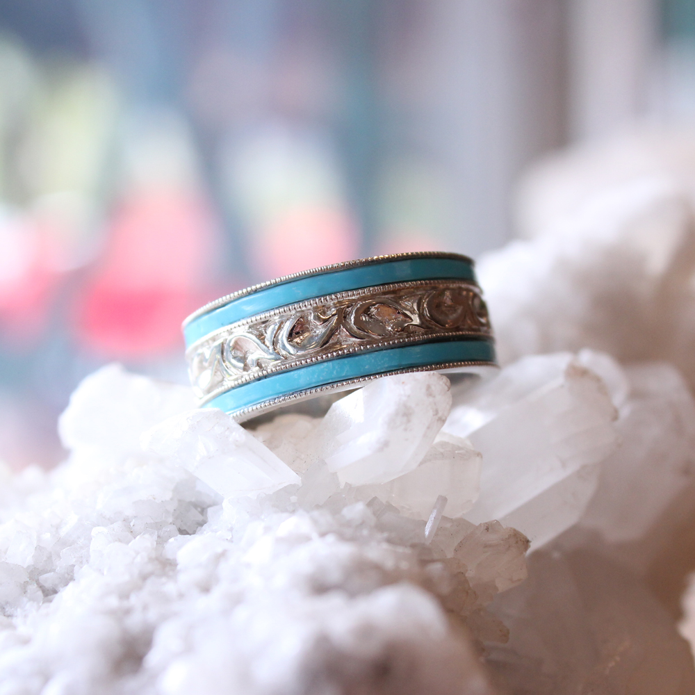 Bespoke wedding band with turquoise inlays among scroll details and milgraining.