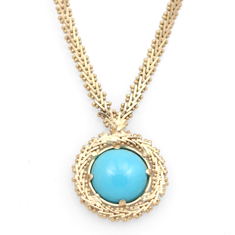 One of a kind turquoise necklace with heavy custom gold chain.