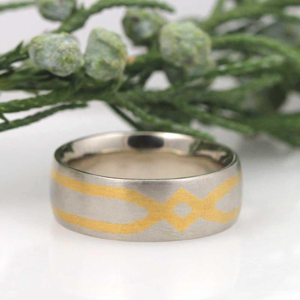 Custom wedding band with Damascene detailing designed by the groom.