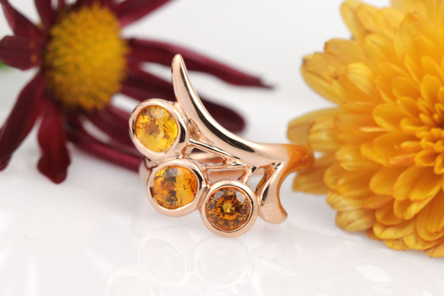 A custom floral-inspired 18k rose gold ring with gorgeous sapphires.