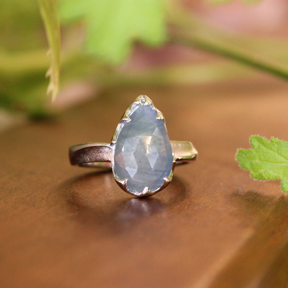 Pear cut gray sapphire in a custom platinum mounting.