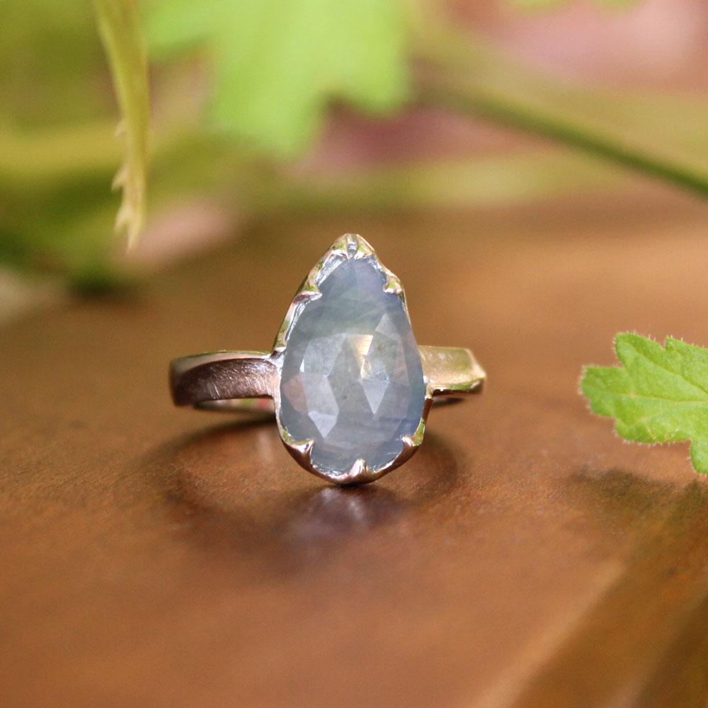 Pear cut gray sapphire in a custom platinum mounting.