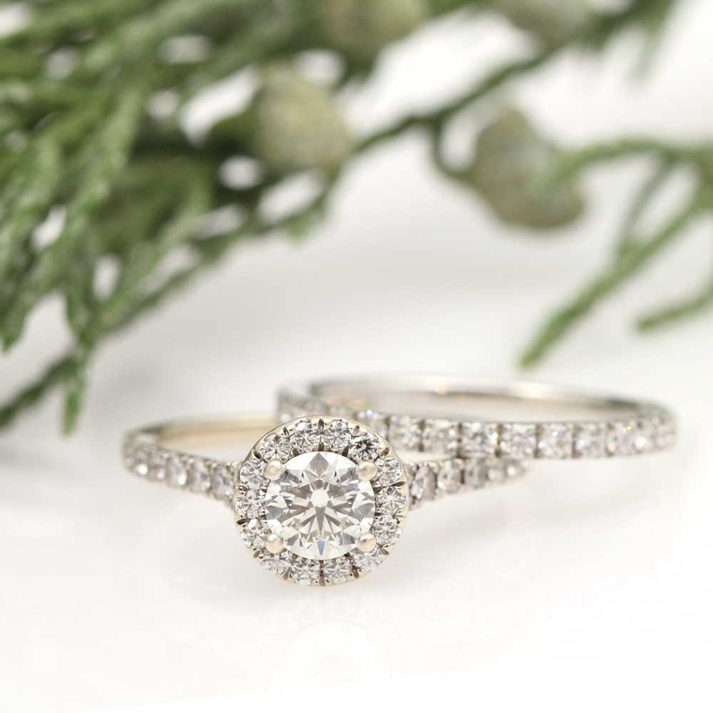 Lively diamond halo wedding set in platinum.
