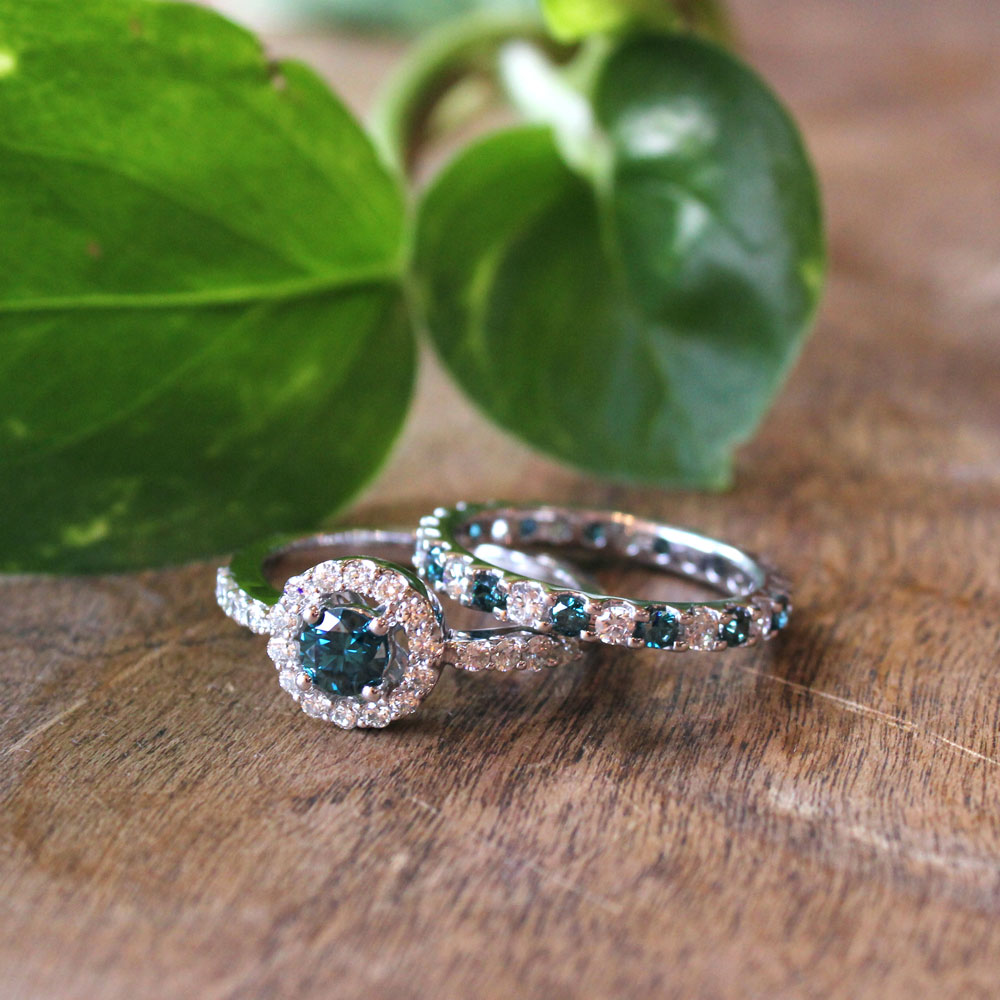Blue diamond halo engagement ring and blue diamond eternity band.