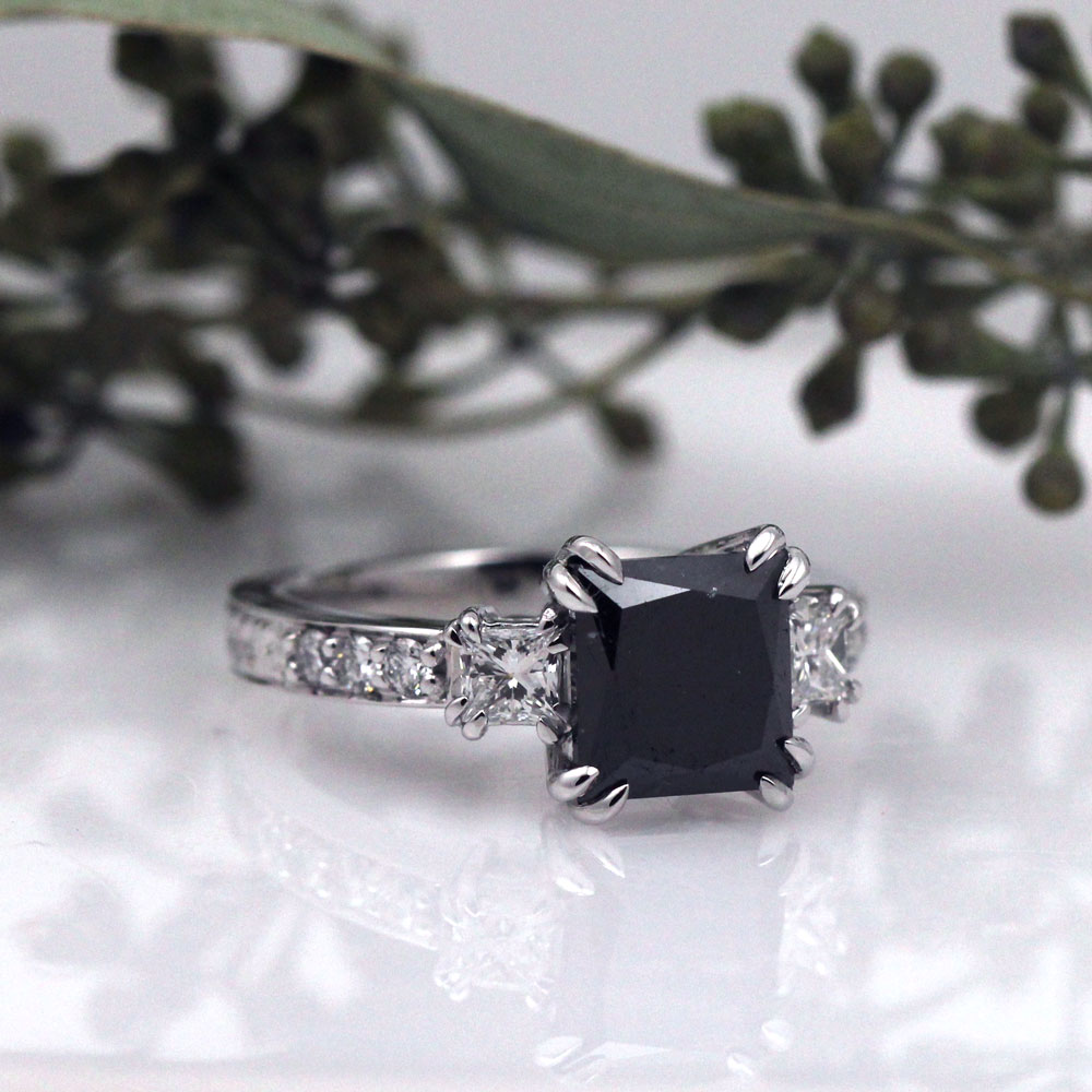Claw prongs heighten the drama of this black diamond engagement ring.