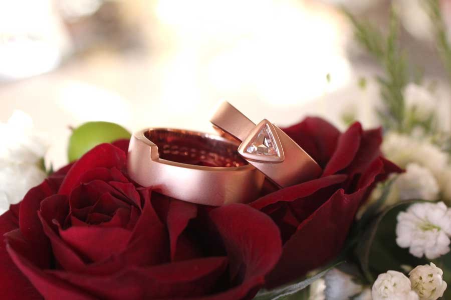 Puzzle piece rose gold wedding bands that interlock.