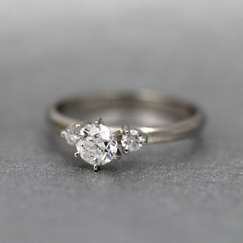 3 stone engagement ring with old Euro cut diamonds