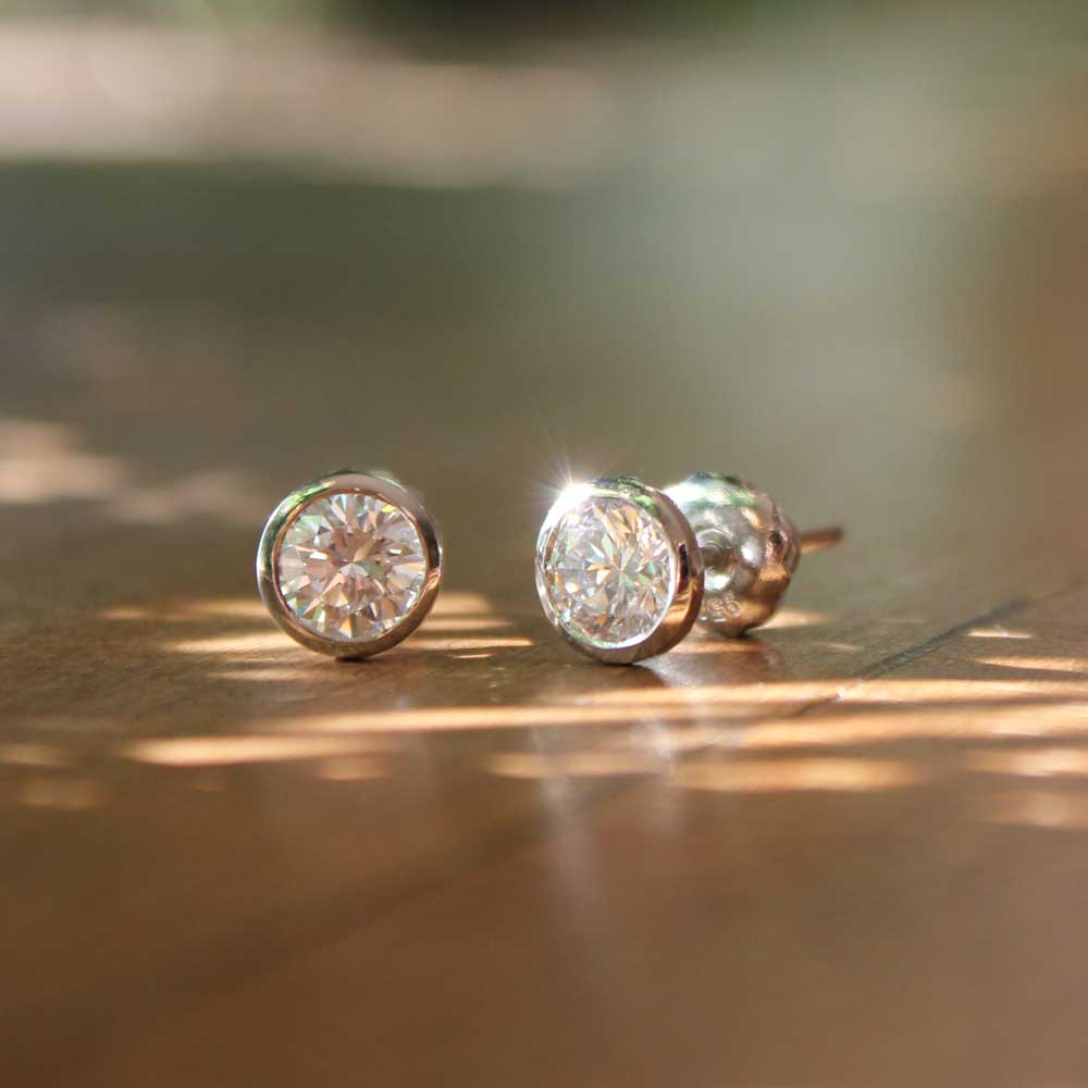 Diamonds in platinum studs.