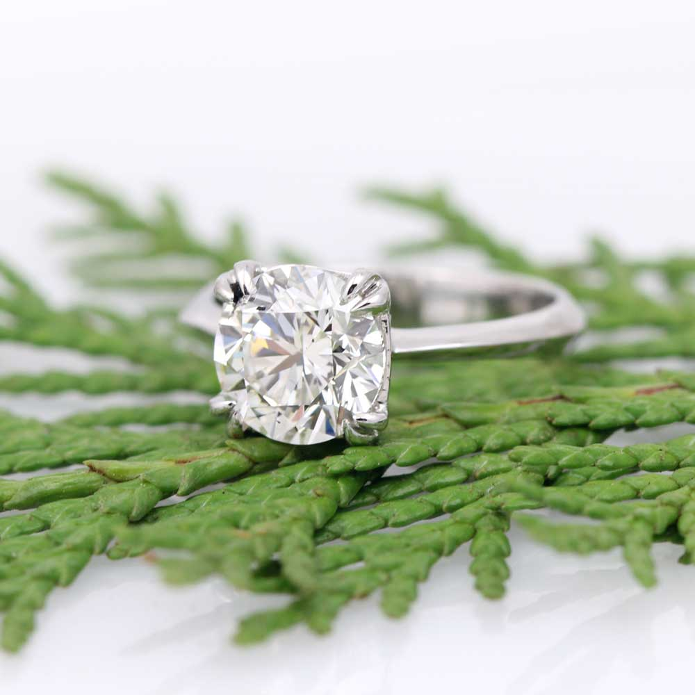 Handmade diamond engagement ring in platinum with romantic details.