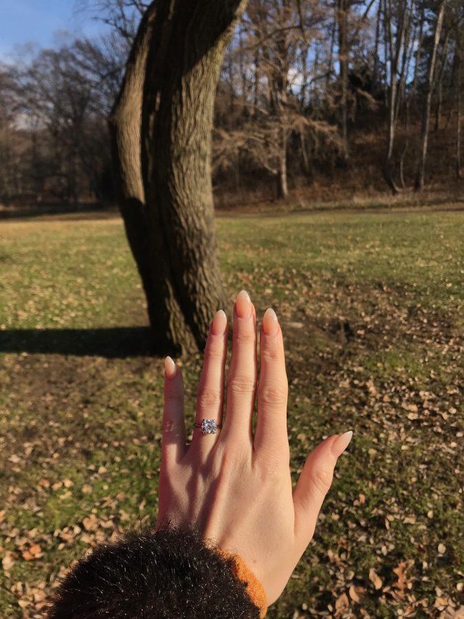 Handmade diamond engagement ring in platinum with romantic details.