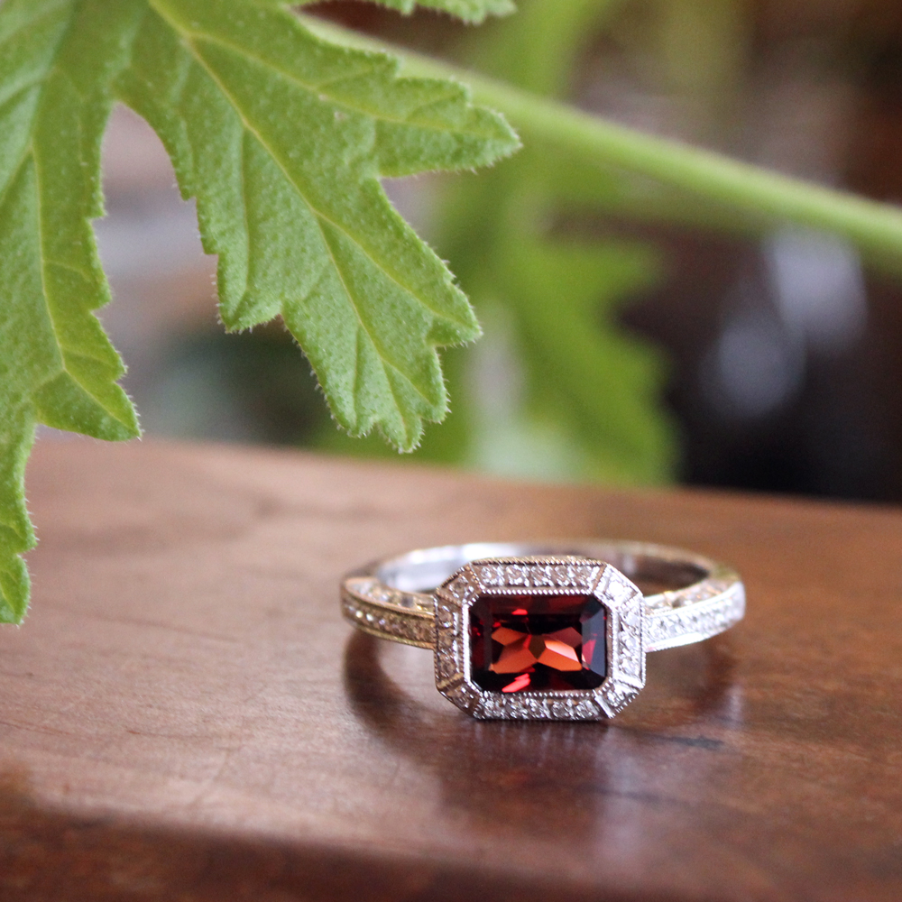 Deco style garnet ring with diamond halo