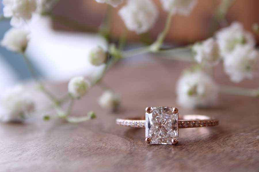 Custom rose gold radiant cut diamond engagement ring.