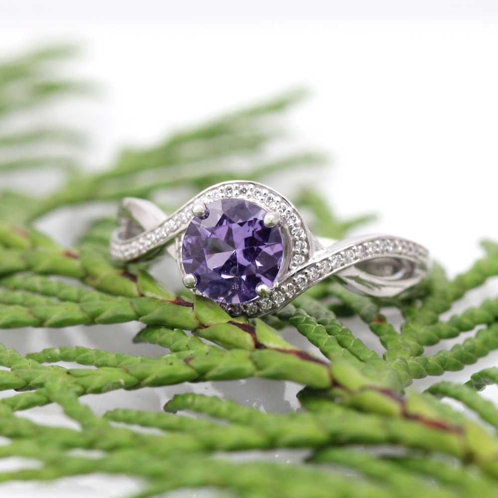 Purple sapphire and diamonds in a platinum infinity engagement ring.